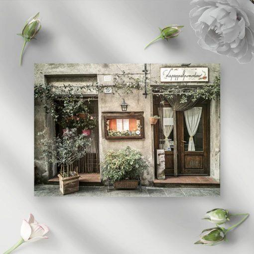 Obraz z restauracyjką oraz szyldem